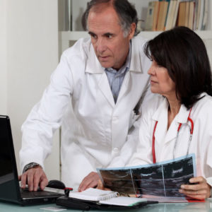 doctors at laptop