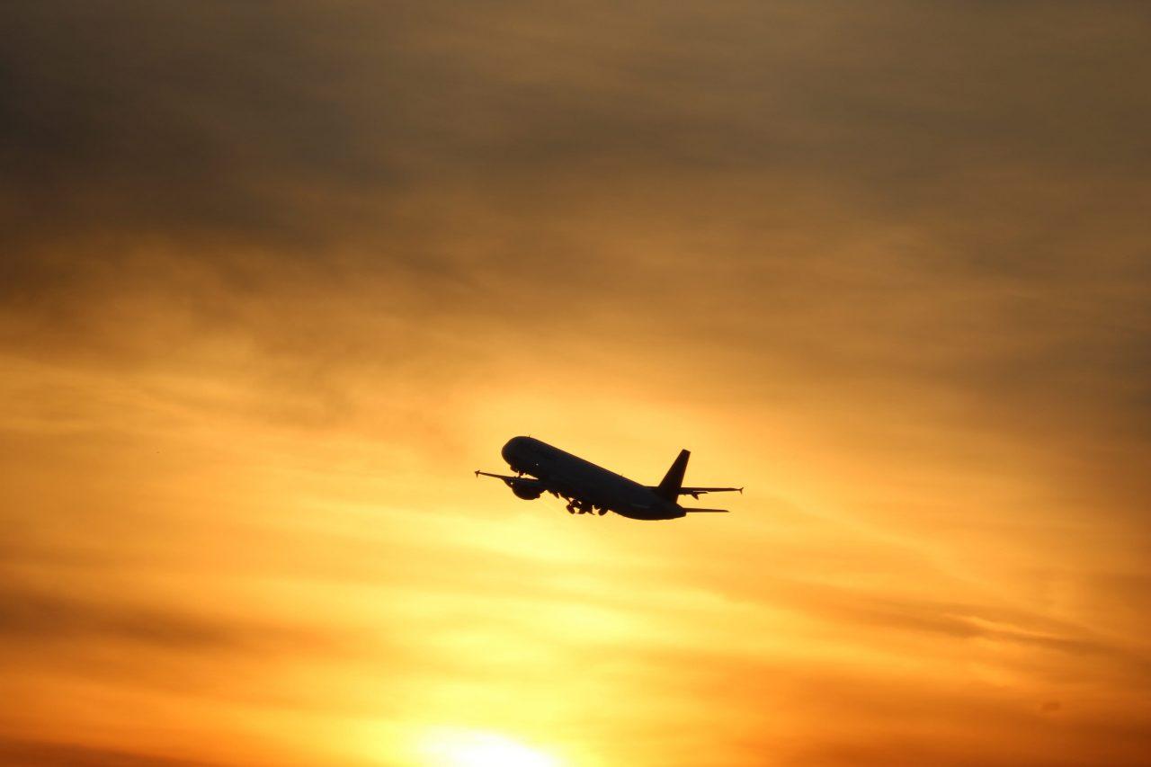 Airplane in sunny sky
